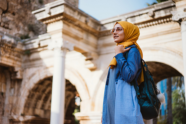 Young muslim woman traveller in Kaleici (old town of Antalya)